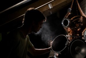Barney working with the still at Caproulus Distillery