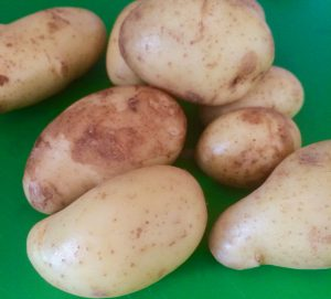 Choose small new potatoes and cut them in half