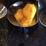 One scoop or two? Let's make it three scoops of mango ice cream.