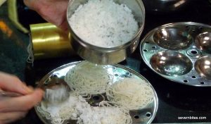 Idli - rice noodles made with the special brass implement behind. Topped with more rice
