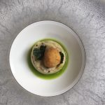 Crispy quail's egg with truffle mash and parsley oil
