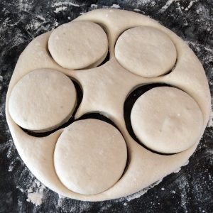 Roll out the doughnut (donut) dough, and cut circles