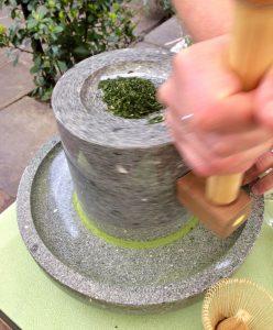 Matcha tea powder by hand