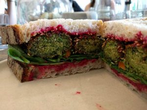 Falafal and beetroot slaw in freshly baked sourdough at Twelve Triangles