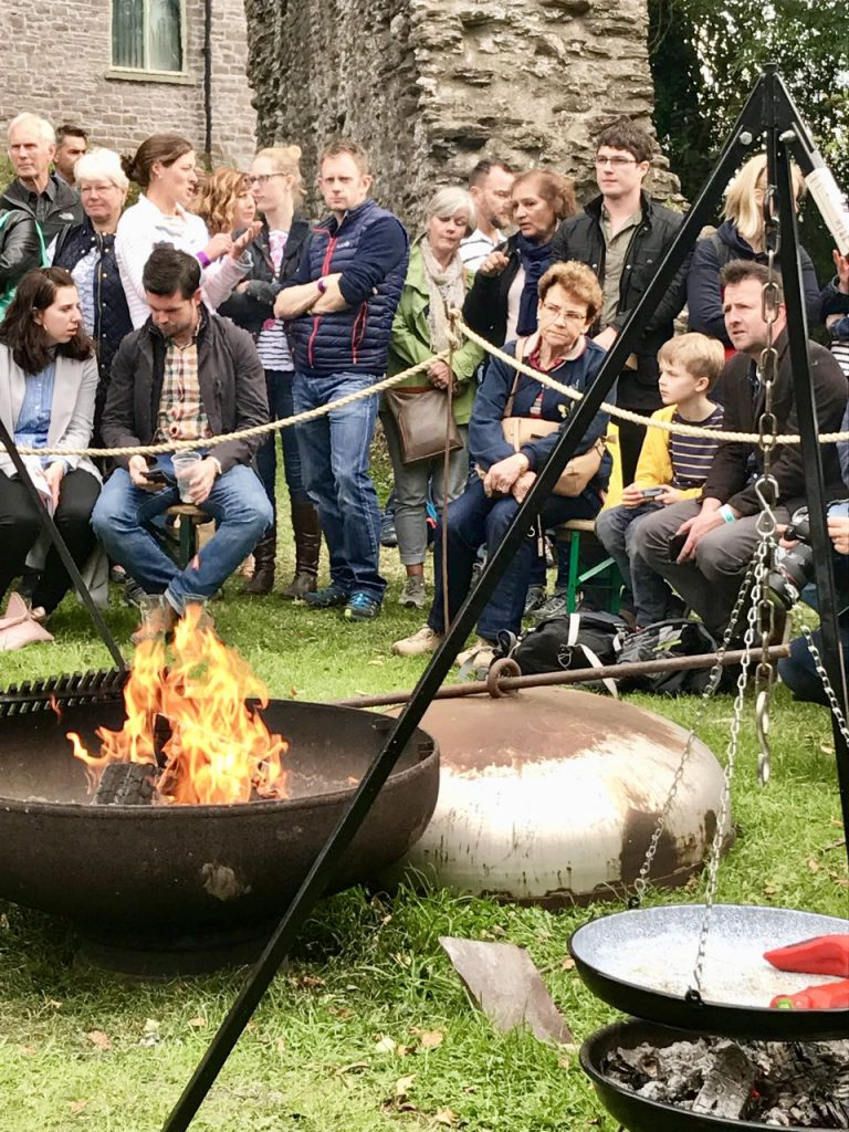 Toasting ourselves around the cauldron waiting for the demo to start Abergavenny Food Festival