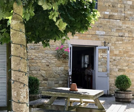 The cool courtyard at the Churchill Arms