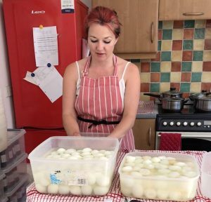 Caroline starting the process of pickling eggs