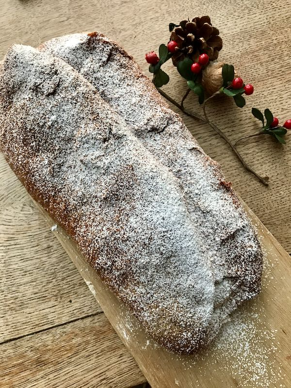 Stollen sprinkled with icing sugar