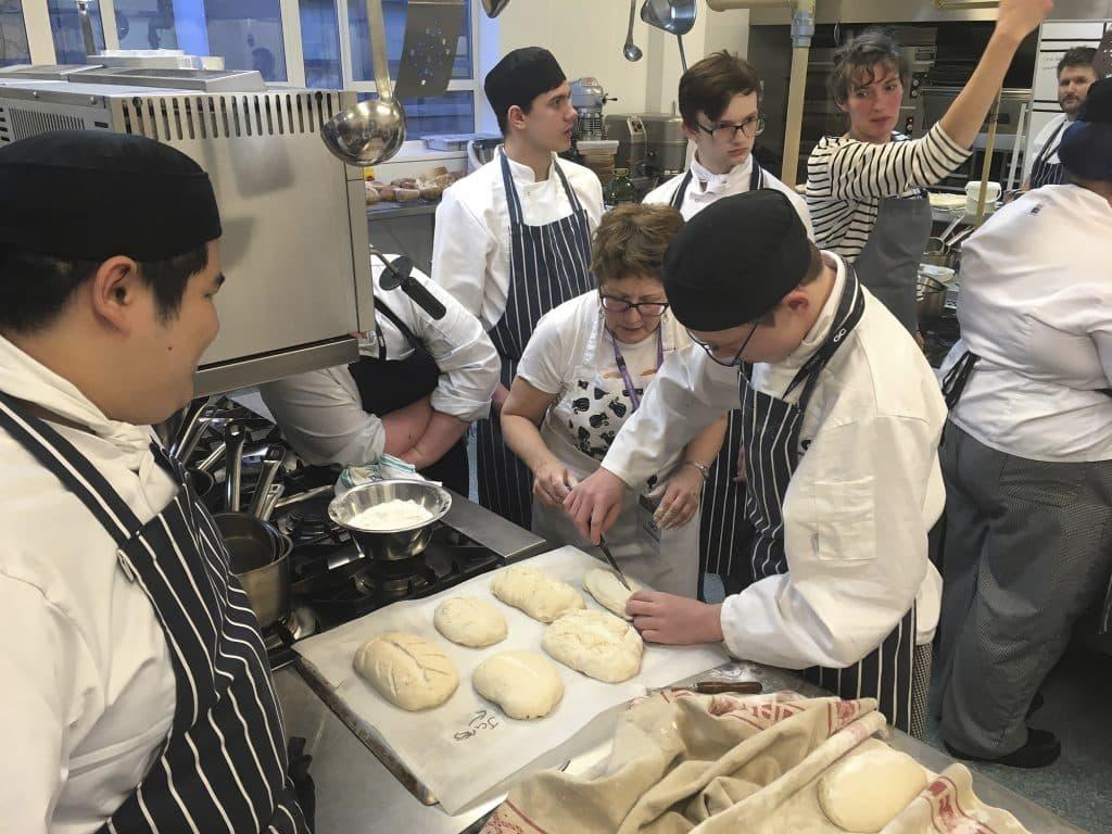 scoring the bread Photo copyright Douglas Muir